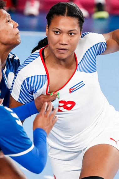 Lorena Tellez holds the ball during the match against Cuba