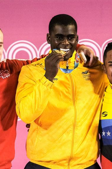 Boady Santavy, Jhonatan Rivas and Keydomar Vallenilla showing medals won at Lima 2019 Games