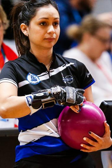 Eugenia Quintanilla holds the ball to throw it on the bowling lane