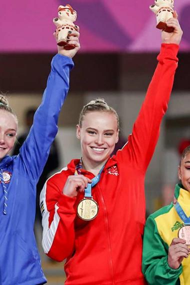 Riley MC Cusker, Elsabeth Black, and Flavia Saraiva show her medals after winning the artistic gymnastics competitions at Lima 2019 in Villa El Salvador Sports Center
