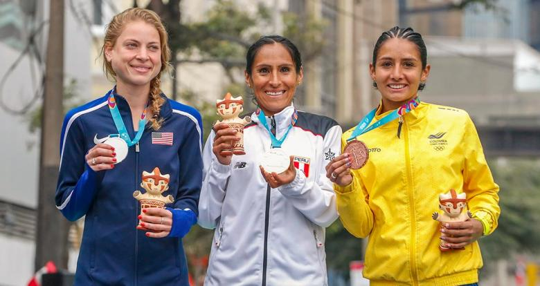 Winners of the women's marathon show their medals and presents
