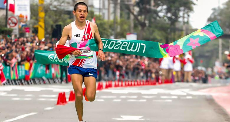 Christian Pacheco crosses the finish line in men's marathon