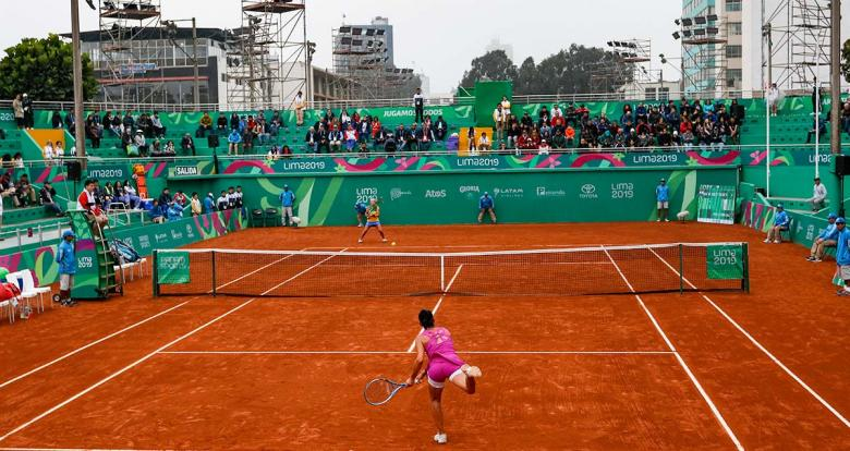 Veronica Cepede from Paraguay and Carolina Alves from Brazil in the Lima 2019 tennis competition held at the Lawn Tennis Club