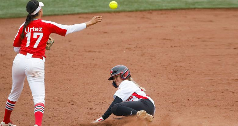 Jennifer Gilbert from Canada in a cloud of dust competing against Anissa Urtez from Mexico in the Lima 2019 women's softball preliminary round held at the Villa María del Triunfo Sports Center