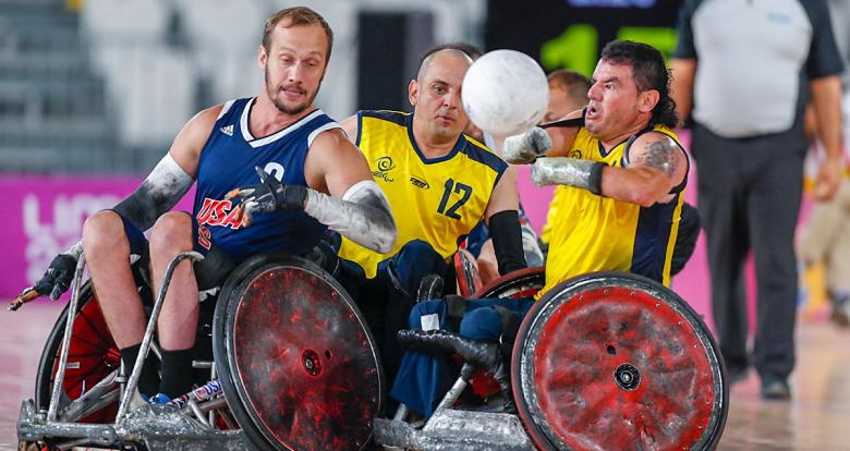 American Eric Newby and Colombian Moisés Alonso fight for the ball in wheelchair rugby at the Villa El Salvador Sports Center at Lima 2019