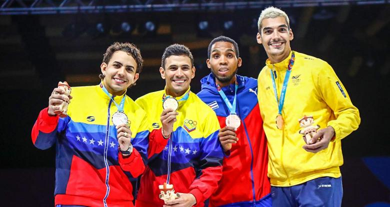 Medalists of Venezuela, Cuba and Colombia in the men's individual fencing event at the Lima Convention Center (LCC)