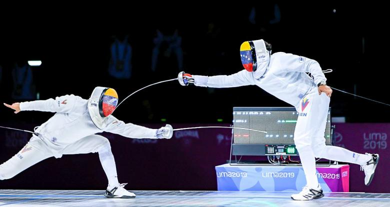 Venezuelan fencers fight in a duel during the men's individual épée final at the Lima Convention Center