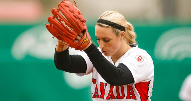 Danielle Lawrie from Canada holds the ball in a match against Mexico in the Lima 2019 women's softball preliminary round held at the Villa María del Triunfo Sports Center