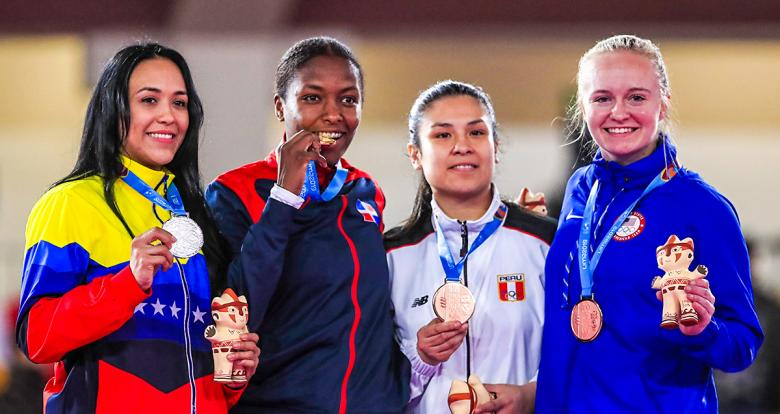 Omaira Molina from Venezuela, Pamela Rodriguez from the Dominican Republic, Isabel Aco from Peru and Cirrus Lingl from the US show the medals they won in women's karate at the Lima 2019 Games.