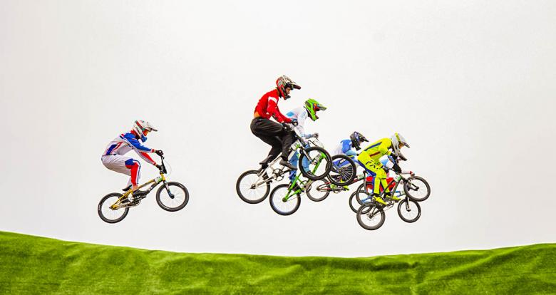 BMX racers of the Americas meet mid-air during the Lima 2019 BMX competition at Costa Verde San Miguel