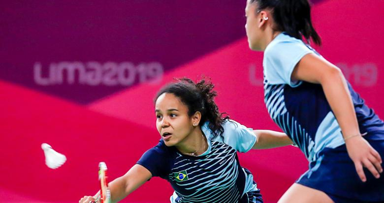 Santos Tamires and Fabiana Silva from Brazil respond to a Canadian attack in a badminton doubles event held at the National Sports Village – VIDENA at the Lima 2019 Pan American Games