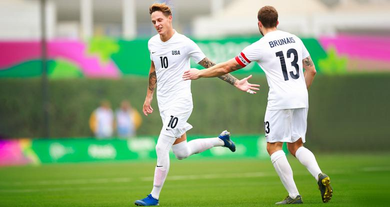 American Nicholas Mayhugh celebrates a goal scored against Venezuela in the match for the football 7-a-side bronze medal at the Villa María del Triunfo Sports Center at Lima 2019.
