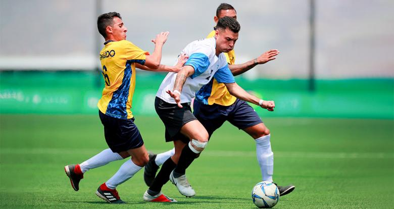 Argentinian Hernando Romussi and Brazilian Leonardo Giovani dispute the ball in the football 7-a-side final at the Villa María del Triunfo Sports Center at Lima 2019.
