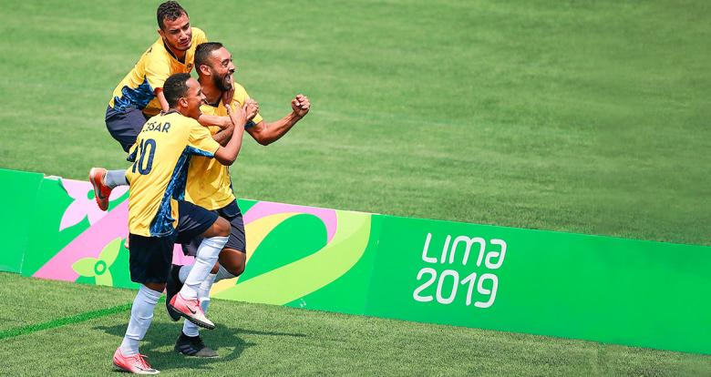 Brazilian players celebrate their goal in the football 7-a-side final against Argentina at Lima 2019, held at the Villa María del Triunfo Sports Center.