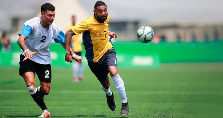 Argentinian Hernando Romussi and Brazilian Ubirajara Da Silva dispute the ball in the Lima 2019 football 7-a-side final at the Villa María del Triunfo Sports Center.