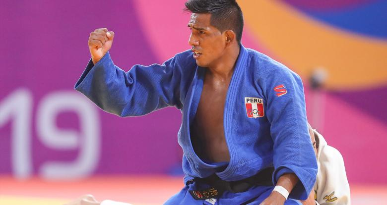 Peruvian judoka Juan Postigos goes up against Colombian Jorge Gonzales in the Lima 2019 men's -66 kg competition at the National Sports Village – VIDENA