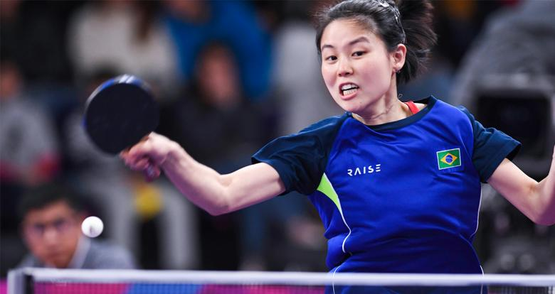 Brazilian Jessica Yamada jumping to hit the ball at the Lima 2019 table tennis match held at the National Sports Village – VIDENA.