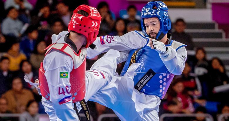 Costa Rica's Andres Molina faces off against Brazil's Bruno da Mota in Lima 2019 men's Para taekwondo K44 -75 kg at the Callao Regional Sports Village.