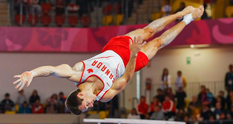 René Cournoyer from Canada soars through the air in the men's artistic gymnastics competition at the Lima 2019 Games, in the Villa el Salvador Sports Center