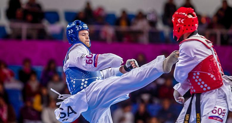 Francisco Pedroza from Mexico and Evan Medell from the USA compete in the men's Para taekwondo K44 +75 kg final at the Callao Regional Sports Village.