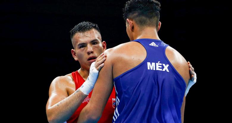 Peruvian Jose Lucar competing against Mexican Francisco Cantabrana during the Lima 2019 men's heavyweight (91 kg) boxing quarterfinals at the Callao Regional Sports Village