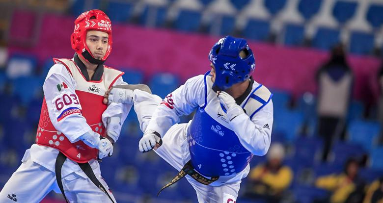 Edgar Torres from Mexico and Dayan Sosa from Cuba compete for the bronze in men's Para taekwondo K44 +75 kg at the Callao Regional Sports Village.