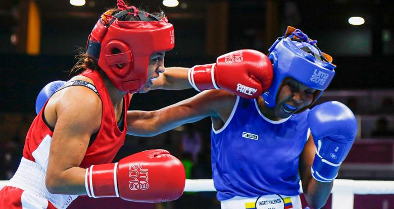 Peruvian Lucy Valdivia competing against Colombian Ingrit Valencia during the Lima 2019 women's flyweight (48 – 51 kg) boxing quarterfinals at the Callao Regional Sports Village.