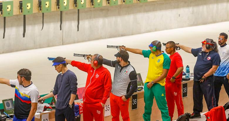 Athletes from all over the Americas during men's 10 m air pistol competitions at Las Palmas Air Base.