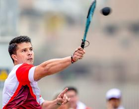 Peruvian fronton player Cristopher Martínez about to strike the ball back to Mexican Isaac Pérez during fronton qualification at the Villa María del Triunfo Sports Center, at the Lima 2019 Pan American Games