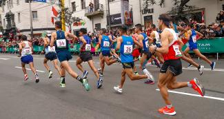 Athletes run on the road for the Lima 2019 marathon