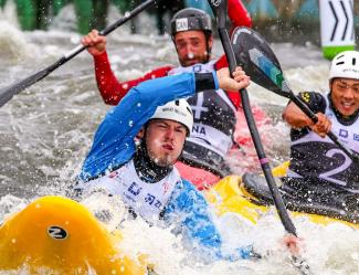 Paddlers compete in an extreme canoe slalom event.