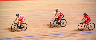 Cyclists facing off during a track cycling event.