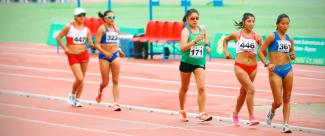 A group of female athletes competing against each other in a race walking event.
