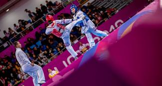 Leylianne Samara from Brazil faces off against Idalianna Quintero from Cuba in women's Para taekwondo K44 +58 kg at the Callao Regional Sports Village.