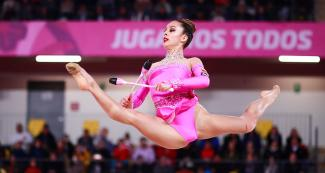 Colombian gymnast Lina Dussan performing a pirouette at the Villa El Salvador Sports Center in Lima 2019