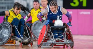American Raymond Hennagir III and Colombian Paola Martinez fight for the ball in the Lima 2019 wheelchair rugby match at the Villa El Salvador Sports Center