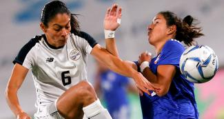 Costa Rica's Carol Sanchez faces off Paraguay's Fabiola Sandoval for the Lima 2019 women's football bronze medal at San Marcos Stadium
