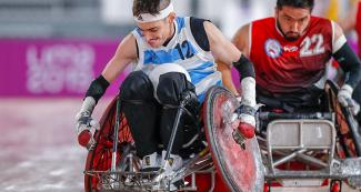 Argentinian Mariano Gastaldi holds the ball in the Lima 2019 wheelchair rugby match against Chile at the Villa El Salvador Sports Center