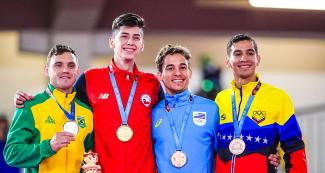 Douglas Brose from Brazil, Joaquín González from Chile, Maximiliano Larrosa from Uruguay and Jovanny Martinez from Venezuela show the medals they won in the Lima 2019 Games karate competition, at the Villa María del Triunfo Sports Center.