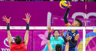 Volleyball player María Margarita Martínez of Colombia spikes the ball. She scored 11 points against Peru at the Lima 2019 Games.
