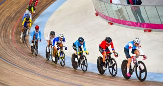 Maggie Coles-Lyster of Canada, Aranza Villalón of Chile and Lina Hernández of Colombia compete in the Lima 2019 track cycling events at the velodrome of the National Sports Village – VIDENA.