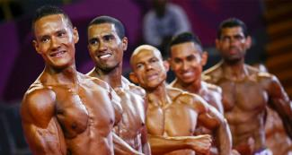 The Mexican Carlos Suarez, the Ecuadorian Angelo Ronquillo Carpio, the Costa Rican Evaristo Cortes, the Guatemalan Jonathan Martinez Catalan, and the Nicaraguan Jorge Callejas posing during the bodybuilding competition at Lima 2019.