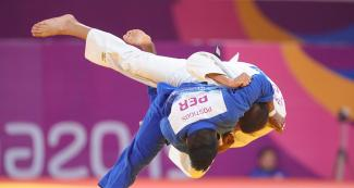mbian judoka Jorge Gonzales goes up against Peruvian Juan Postigos in the Lima 2019 men's -66 kg competition at the National Sports Village – VIDENA
