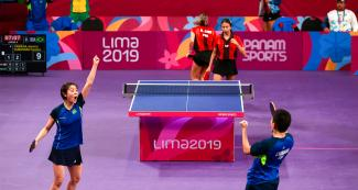 Jessica Yamada and Caroline Kumahara from Brazil celebrating point at the Lima 2019 table tennis match vs. Puerto Rico at the National Sports Village – VIDENA.
