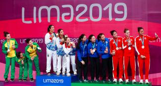 Brazil, Puerto Rico, USA and Canada women's teams showing their Lima 2019 table tennis medals obtained at the National Sports Village – VIDENA.