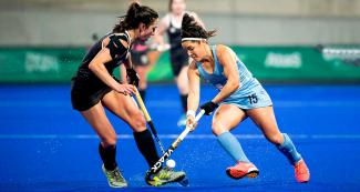 Argentinian Maria Jose Granatto faces off a Canadian athlete during the Lima 2019 hockey match for the gold at the National Sports Village (VIDENA)