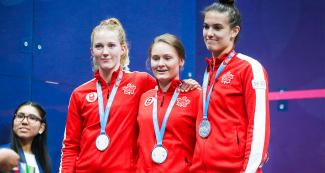 Canadians Danielle Letorneau, Hollie Naughton and Samantha Cornett competed in women's squash and won the silver medal at Lima 2019