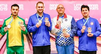Marcelo Suartz from Brazil (silver), Nicholas Pate from the US (gold), Jakob Butturff from the US and Jean Perez from Puerto Rico (bronze) with medals of the men's single bowling competition at the National Sports Village – VIDENA.