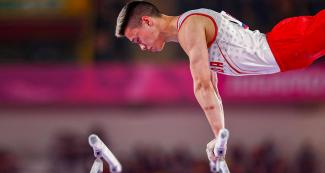 Justin Karstadt from Canada competes in the men's artistic gymnastics event at Lima 2019, in the Villa El Salvador Sports Center.