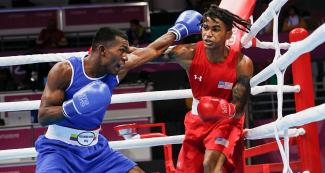 American Delante Johnson facing off Colombian Alexander Rangel in the Lima 2019 men's welterweight (69 kg) boxing event held at the Callao Regional Sports Village.